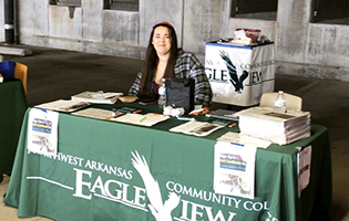 Woman sitting at an EagleView table