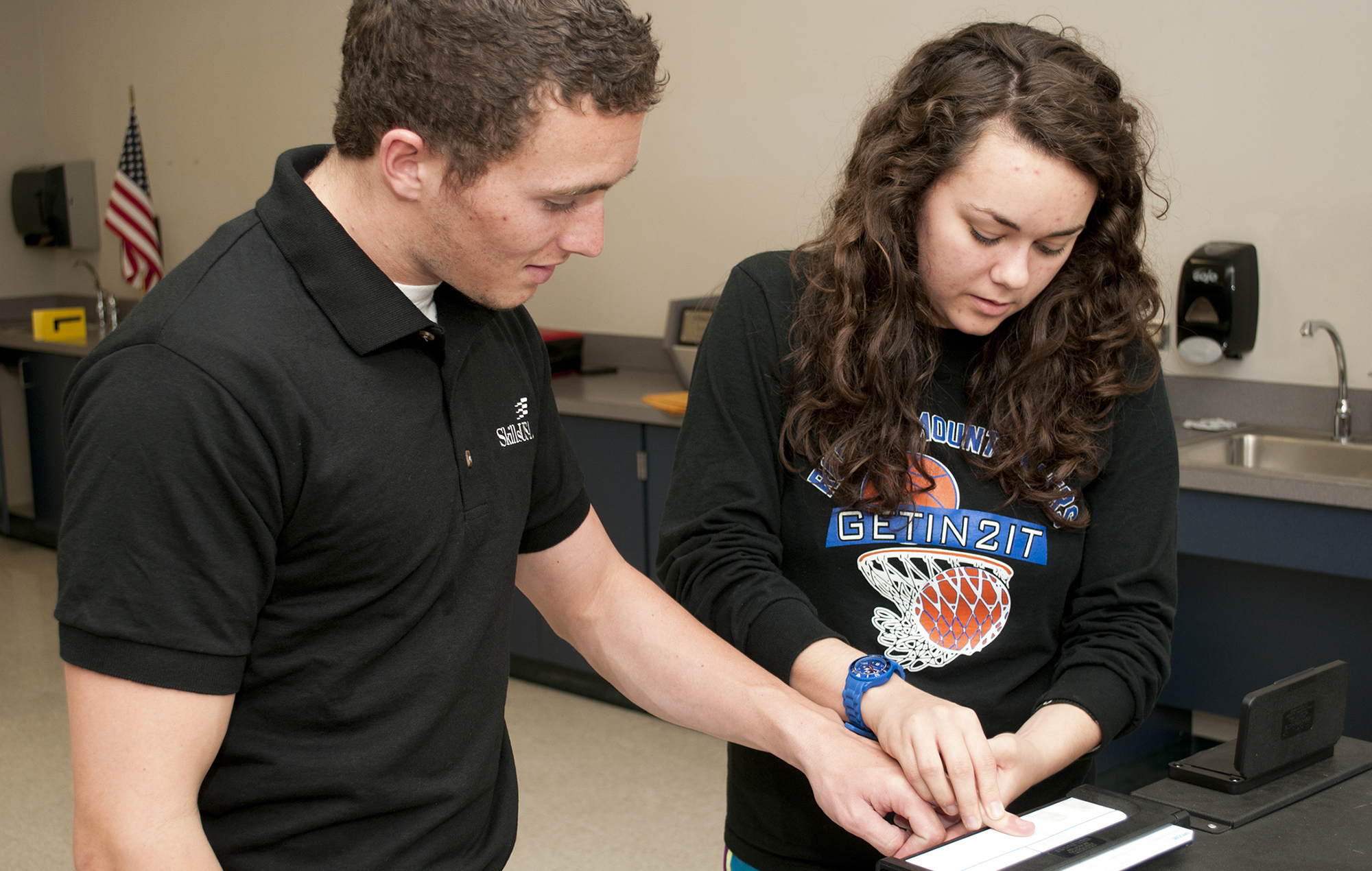 Female Criminal Justice student taking finger prints