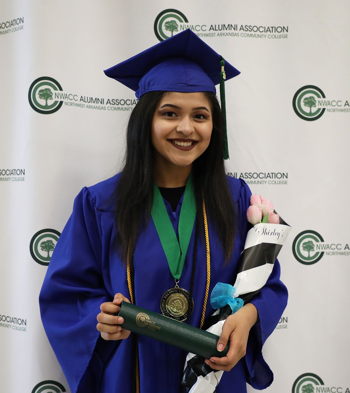 Female high school student in cap and gown